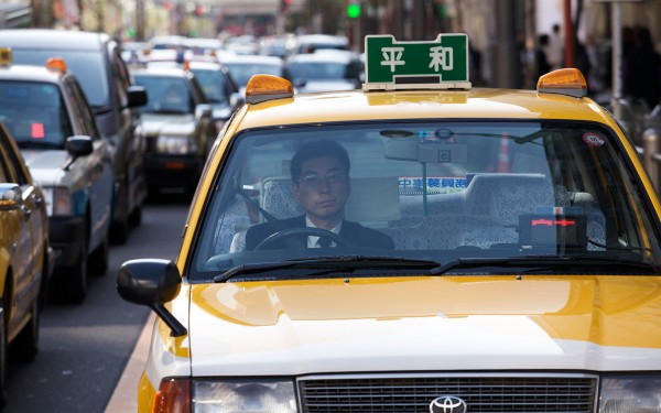 Taxi driver sitting in traffic on Sony street in Ginza area.